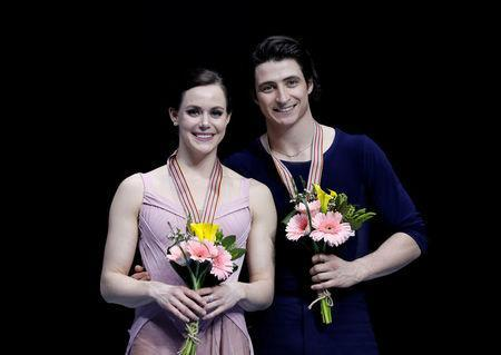 Figure Skating - ISU Four Continents Figure Skating Championships 2017 - Ice Dance Free Dance - Gangneung, South Korea, 17/2/17 - Gold medallists Tessa Virtue and Scott Moir of Canada attend the ceremony. REUTERS/Kim Hong-Ji/File Photo