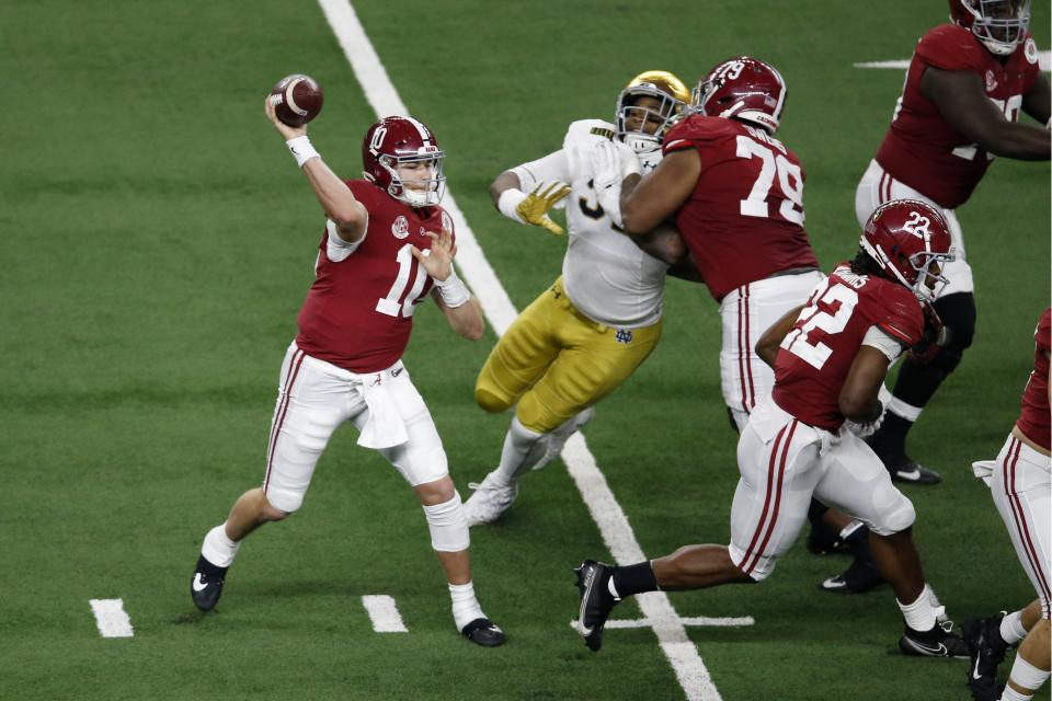 Alabama QB Mac Jones (10) throws a pass under pressure from the rush by Notre Dame in the second half of the Rose Bowl on Jan. 1. (AP)