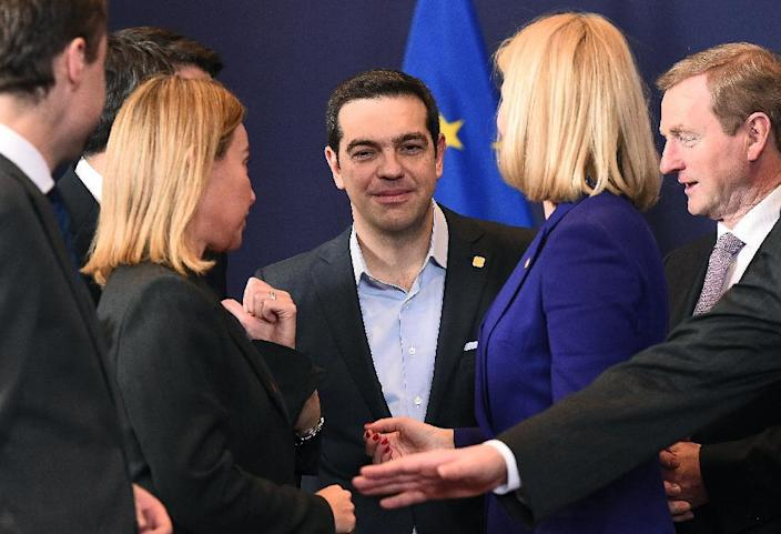 Greek Prime Minister Alexis Tsipras (C) speaks with EU foreign policy chief Federica Mogherini (L), Danish Prime Minister Helle Thorning-Schmidt (2-R) and Irish Prime Minister Enda Kenny (R) in Brussels on February 12, 2015 (AFP Photo/Emmanuel Dunand)