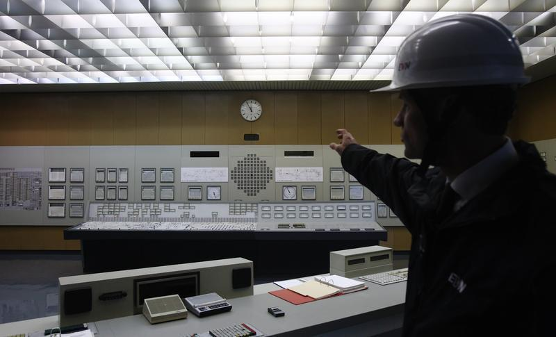 A spokesperson of EVN the company owning Austria's unique nuclear power plant shows the switching station in Zwentendorf