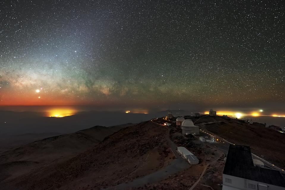 The two brightest planets in the night sky, Venus and Jupiter, meet up for a conjunction in front of the Milky Way's shimmering core in this view from the La Silla Observatory in Chile.
