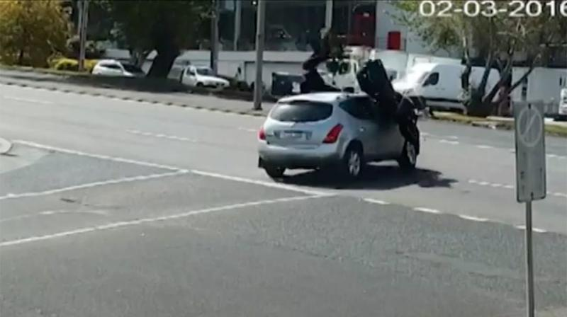 The motorcyclist had no time to react and was sent flying over the bonnet. Source: 7 News