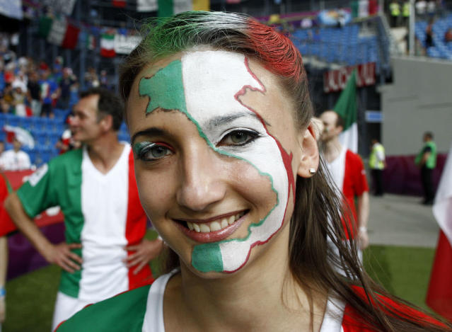 An Italian fan smiles prior to the Euro 2012 soccer championship Group C match between Italy and the Republic of Ireland in Poznan, Poland, Monday, June 18, 2012. (AP Photo/Jon Super)