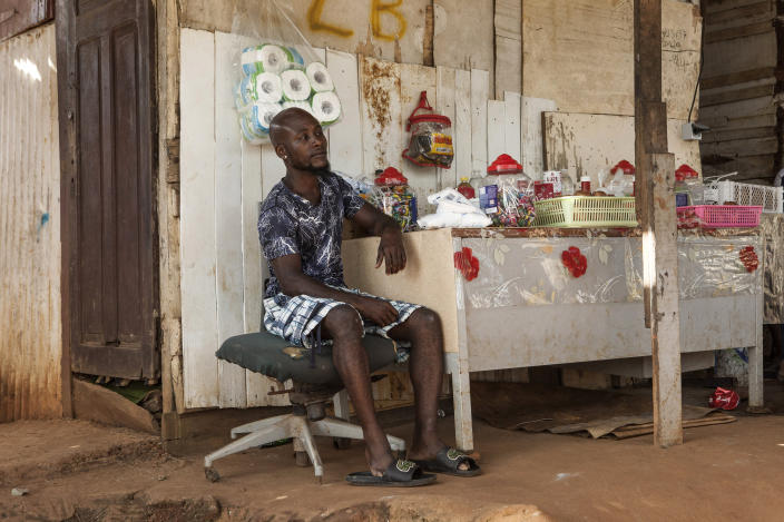 A man waits for customers in his shop in the slum district of Mont Baduel, in Cayenne, French Guiana, Friday, July 10, 2020. France's most worrisome virus hotspot is in fact on the border with Brazil - in French Guiana, a former colony where health care is scarce and poverty is rampant. The pandemic is exposing deep economic and racial inequality in French Guiana that residents say the mainland has long chosen to ignore. (AP Photo/Pierre Olivier Jay)