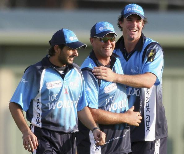 MELBOURNE, AUSTRALIA - OCTOBER 2: Shahid Afridi of Pakistan, Jacques Kallis of South Africa and Kevin Pietersen of England celebrates a wicket during the ICC World Xl v Victorian Bushrangers match at Junction Oval October 2, 2005 in Melbourne, Australia. (Photo by Quinn Rooney/Getty Images)