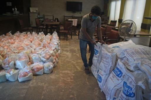 Food packets are prepared by the Mumbai Press Club to be distributed to journalists laid off during the current COVID-19 pandemic and economic crisis, in Mumbai