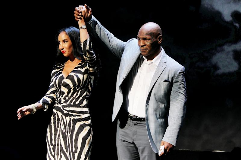 "FILE - This Aug. 2, 2010 file image released by Starpix shows former boxer Mike Tyson, right, and his wife Kiki Tyson at the curtain call for the opening night of ""Mike Tyson: Undisputed Truth,""  at the Longacre Theatre in New York.  The one man show starring Tyson was directed by Spike Lee, and written by Kiki Tyson. (AP Photo/Starpix, Amanda Schwab)"