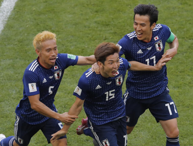 Japan's Yuya Osako, centre, celebrates after scoring his side's 2nd goal with teammates Makoto Hasebe, right, and Yuto Nagatomo, left, during the group H match between Colombia and Japan at the 2018 soccer World Cup in the Mordavia Arena in Saransk, Russia, Tuesday, June 19, 2018. (AP Photo/Vadim Ghirda)