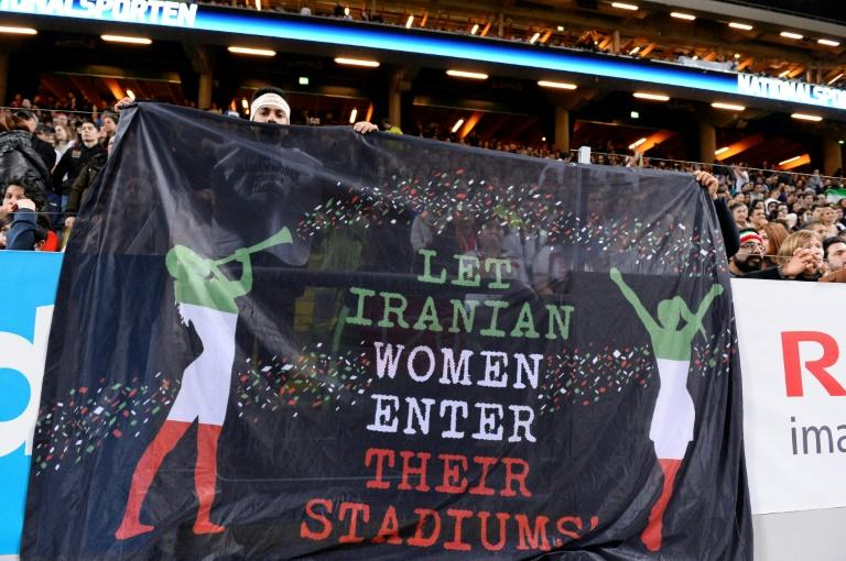 Supporters hold a banner calling for Iranian women to be allowed to enter football stadiums, during a match between Sweden and Iran near Stockholm in March 2015