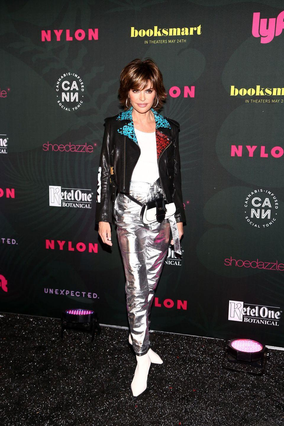 <p>Lisa Rinna is pulling off an '80s trifecta with the graffiti jacket, metallic pants, and belt bag. Not an easy feat! </p>