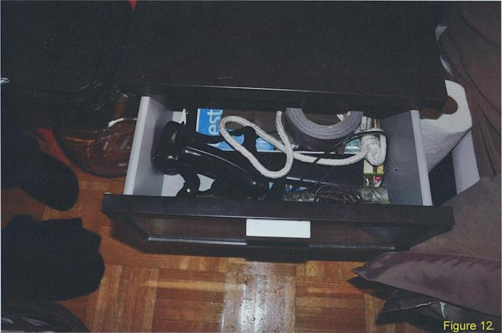 <p>A drawer in McArthur's apartment containing the tape-wrapped bar, rope and duct tape. The photo was taken when police covertly entered McArthur's apartment in Dec. 7, 2017. (Photo provided by the Crown) </p>