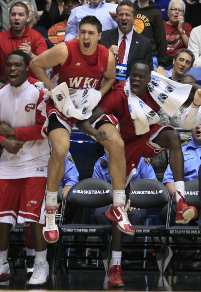 Western Kentucky forward Vinny Zollo, center, and forward Teeng Akol, right, leap as Western Kentucky took the lead in the second half of the opening game of the NCAA men's college basketball tournament against Mississippi Valley State, Tuesday, March 13, 2012, in Dayton, Ohio. Western Kentucky won 59-58. (AP Photo/Al Behrman)