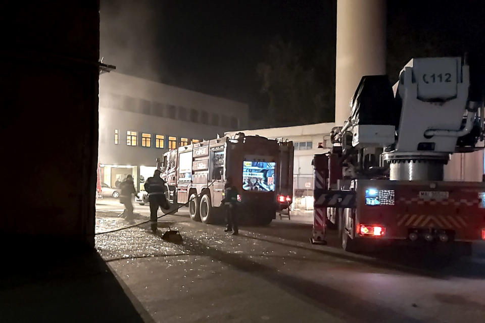 Firefighting engines and ambulances are stationed outside the hospital in Piatra Neamt, northern Romania, Saturday, Nov. 14, 2020. Romanian officials say a fire at a hospital treating COVID-19 patients has killed 10 people and critically injured seven others as a blaze spread through the intensive care ward designated for people with COVID-19 patients at the public hospital according to the Emergency Situations Inspectorate. (ZIarPiatraNeamt.ro via AP)
