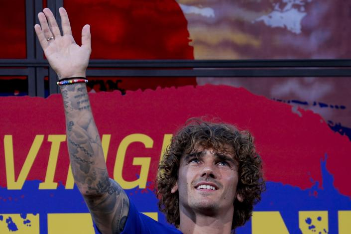 French forward Antoine Griezmann poses for the media during his official presentation after signing for FC Barcelona in Barcelona, Spain, Sunday, July 14, 2019. (AP Photo/Emilio Morenatti)