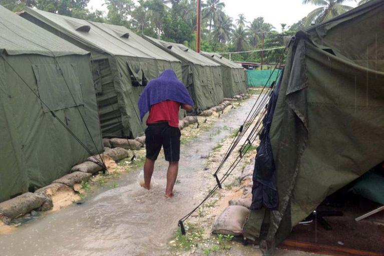 An undated photo obtained from the Refugee Action Coalition on February 18, 2014 shows a man walking between tents at Australia's regional processing centre on Manus Island in Papua New Guinea