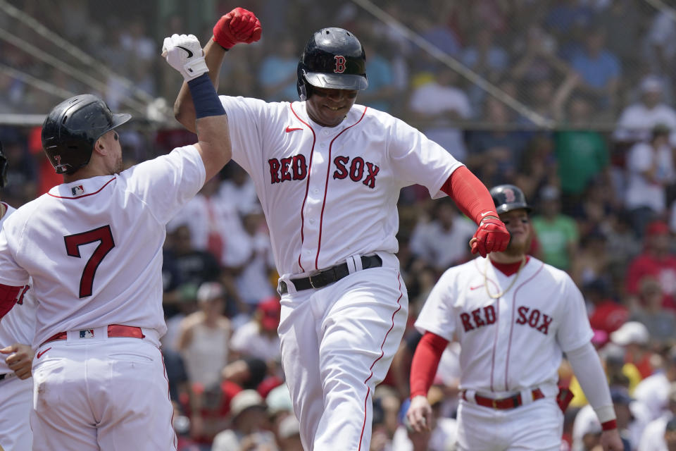 Boston Red Sox's Rafael Devers, center, celebrates his three-run home with Christian Vazquez (7) in the first inning of a baseball game against the New York Yankees, Sunday, June 27, 2021, in Boston. (AP Photo/Steven Senne)