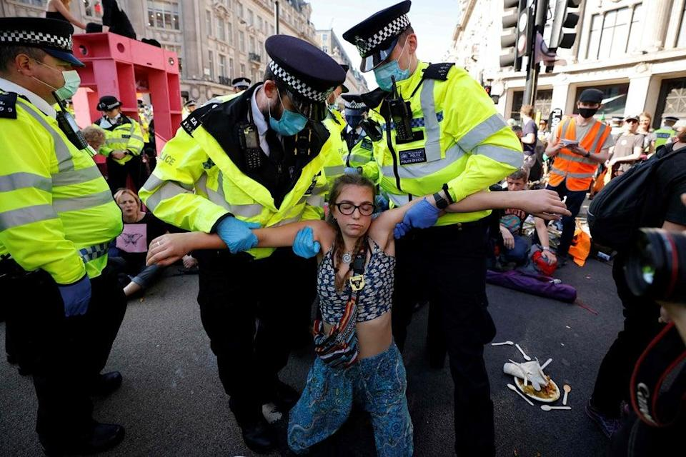 Women with climate messages written on their bodies brought traffic to a standstill (AFP via Getty Images)