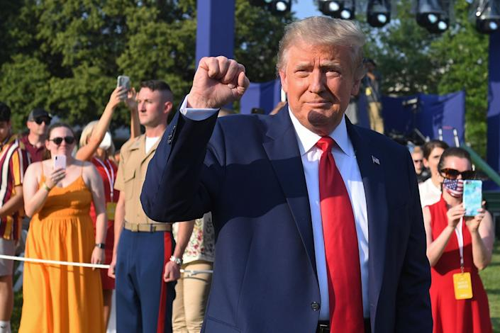 "President Donald Trump pumps his fist as he arrives for the 2020 ""Salute to America"" event in honor of Independence Day on the South Lawn of the White House in Washington, DC, July 4, 2020."