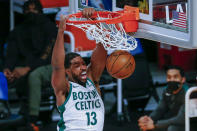 Boston Celtics' Tristan Thompson dunks against the Los Angeles Lakers during the second half of an NBA basketball game Thursday, April 15, 2021, in Los Angeles. (AP Photo/Ringo H.W. Chiu)
