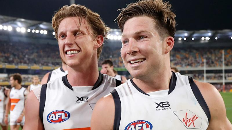 Lachie Whitfield and Toby Greene, pictured here after the Giants' semi-final win.