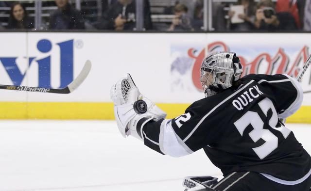 Los Angeles Kings goalie Jonathan Quick blocks a shot from the San Jose Sharks during the first period in Game 4 of an NHL hockey first-round playoff series in Los Angeles, Thursday, April 24, 2014. (AP Photo/Chris Carlson)