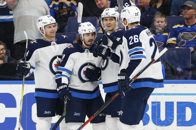 Winnipeg Jets' Nic Petan (19) is congratulated by teammates Josh Morrissey (44), Mark Scheifele (55) and Blake Wheeler (26) after scoring against the St. Louis Blues during the first period of an NHL hockey game Friday, Feb. 23, 2018, in St. Louis. (AP Photo/Billy Hurst)