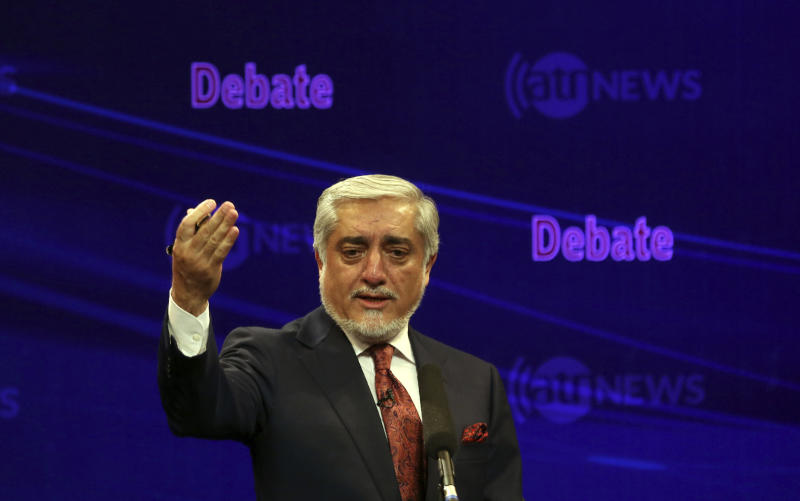 FILE - In this Monday, Sept. 16, 2019 file photo, Afghan presidential candidate Chief Executive Abdullah Abdullah speaks during the first presidential election debate, in Kabul, Afghanistan. The Taliban have warned Afghanistan's 9.6 million eligible voters to stay away from polling stations during the election Saturday, Sept. 28. President Ashraf Ghani and Abdullah Abdullah -- who shared power for five years in a so-called unity government -- are the leading contenders in the election. (AP Photo/Rahmat Gul, File)