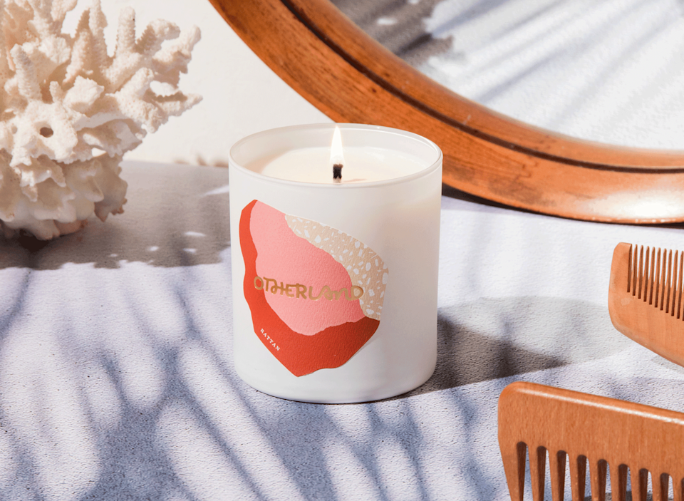 """<h3>Otherland Rattan Candle </h3><br>The praise for this stylish votive — filled with hand-poured soy and coconut wax and scented with an autumnal blend of sandalwood, amber, and moss notes— is lofty. As one reviewer put it: """"[I] Cannot say enough good things about this candle. I have raved about it to so many people and absolutely intend to buy more. The scent throw is impressive and the packaging is exceptional. This product is such a great value for money!""""<br><br><em>Shop <a href=""""https://www.otherland.com/products/rattan"""" rel=""""nofollow noopener"""" target=""""_blank"""" data-ylk=""""slk:Otherland"""" class=""""link rapid-noclick-resp""""><strong>Otherland</strong></a></em><br><br><strong>Otherland</strong> Rattan, $, available at <a href=""""https://go.skimresources.com/?id=30283X879131&url=https%3A%2F%2Fwww.otherland.com%2Fproducts%2Frattan"""" rel=""""nofollow noopener"""" target=""""_blank"""" data-ylk=""""slk:Otherland"""" class=""""link rapid-noclick-resp"""">Otherland</a>"""