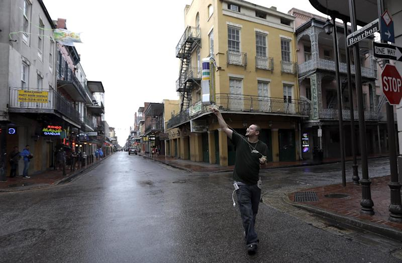 Andrew Theriot flies a kite down Bourbon Street in the French Quarter as rain from Hurricane Isaac falls Tuesday, Aug. 28, 2012, in New Orleans. The U.S. National Hurricane Center in Miami said Isaac became a Category 1 hurricane Tuesday with winds of 75 mph.  (AP Photo/David J. Phillip)