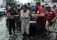Sri Lankan security personnel evacuate residents from low-lying areas of Colombo which has a population of about 650,000 (AFP Photo/Ishara S. Kodikara)