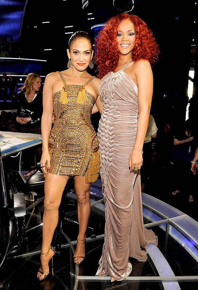 """At """"American Idol's"""" live elimination show Thursday night, Rihanna drew a standing ovation from judges Jennifer Lopez, Steven Tyler, and Randy Jackson when she sang her new single """"California King Bed."""" The flame-haired singer also confirmed that former """"Idol"""" judge Simon Cowell had offered to make her a judge on """"X-Factor,"""" but that she'd turned him down due to her busy schedule. Frank Micelotta/Fox/PictureGroup"""