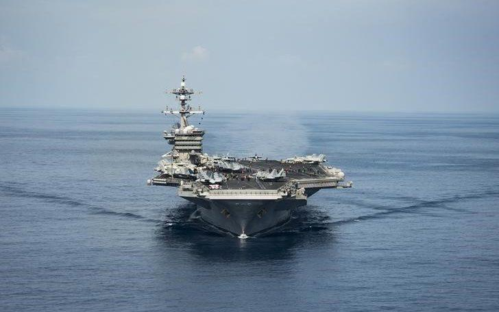 The aircraft carrier USS Carl Vinson transits the South China Sea - Credit: US Navy/Reuters