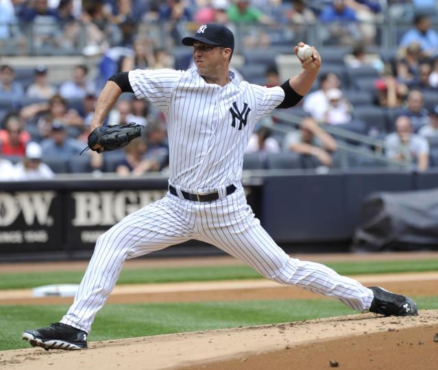 New York Yankees pitcher Chris Capuano delivers the ball to the Toronto Blue Jays during the second inning of a baseball game on Saturday, July 26, 2014, at Yankee Stadium in New York. (AP Photo/Bill Kostroun)