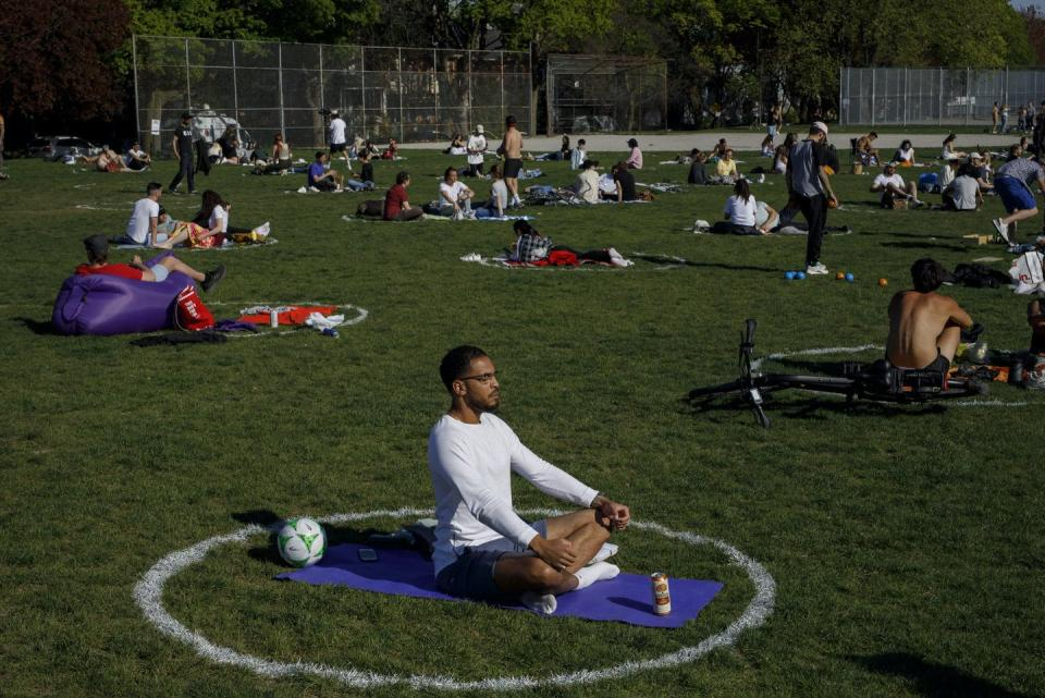 """<span class=""""caption"""">Green spaces are inequitably distributed across cities: The quality and quantity are lower in racialized neighbourhoods.</span> <span class=""""attribution""""><span class=""""source"""">THE CANADIAN PRESS/Cole Burston</span></span>"""