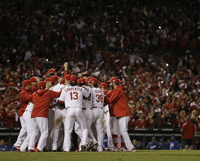 The St. Louis Cardinals celebrate after Game 6 of the National League baseball championship series against the Los Angeles Dodgers, Friday, Oct. 18, 2013, in St. Louis. The Cardinals won 9-0 to win the series. (AP Photo/Jeff Roberson)