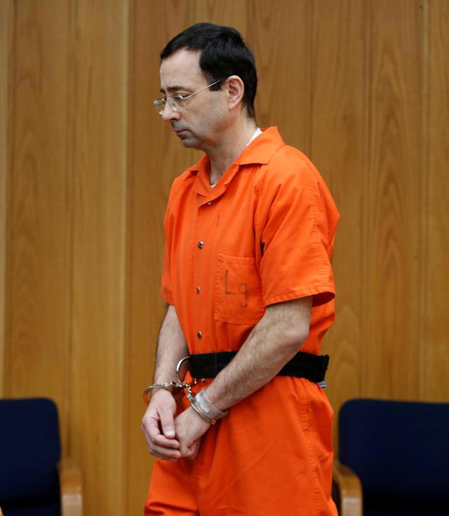 Larry Nassar, a former team USA Gymnastics doctor who pleaded guilty in November 2017 to sexual assault charges, enters the courtroom during his sentencing hearing in the Eaton County Court in Charlotte, Michigan, U.S., January 31, 2018. Picture taken January 31, 2018. REUTERS/Rebecca Cook