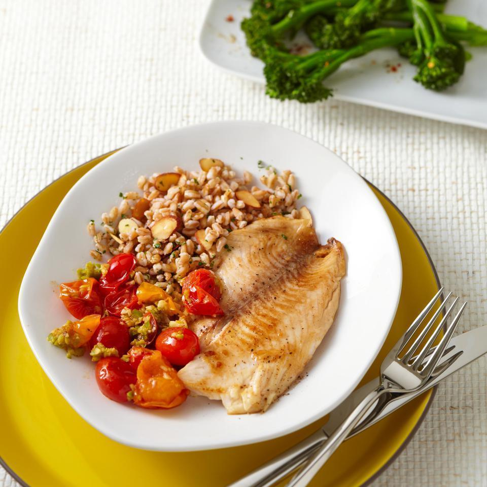 <p>Top tilapia fillets with a savory tomato-olive sauce that comes together in just 5 minutes. Look for tapenade near jarred olives in the supermarket. Serve with sautéed broccolini and farro tossed with toasted almonds.</p>