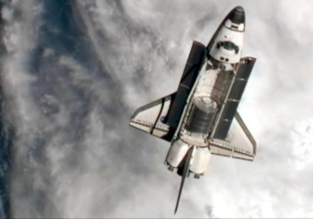 IN SPACE - JULY 10: In this video screen grab provided by the National Aeronautics and Space Administration (NASA), NASA space shuttle Atlantis goes through a nine-minute Rendezvous Pitch Maneuver, or back flip to enable space station crew members to take high resolution digital pictures of the shuttle's heat shield July 10, 2011 in space. After the back flip is complete, Commander Chris Ferguson will fly Atlantis through a quarter circle to a position about 310 feet directly in front of the station, allowing the complex to catch up with the shuttle for docking Atlantis is embarking on a 12-day mission on July 8 to the International Space Station where it will deliver the Raffaello multi-purpose logistics module packed with supplies and spare parts. This will be the final launch of the space shuttle program, which began on April 12, 1981 with the launch of Colombia. (Photo by NASA via Getty Images)