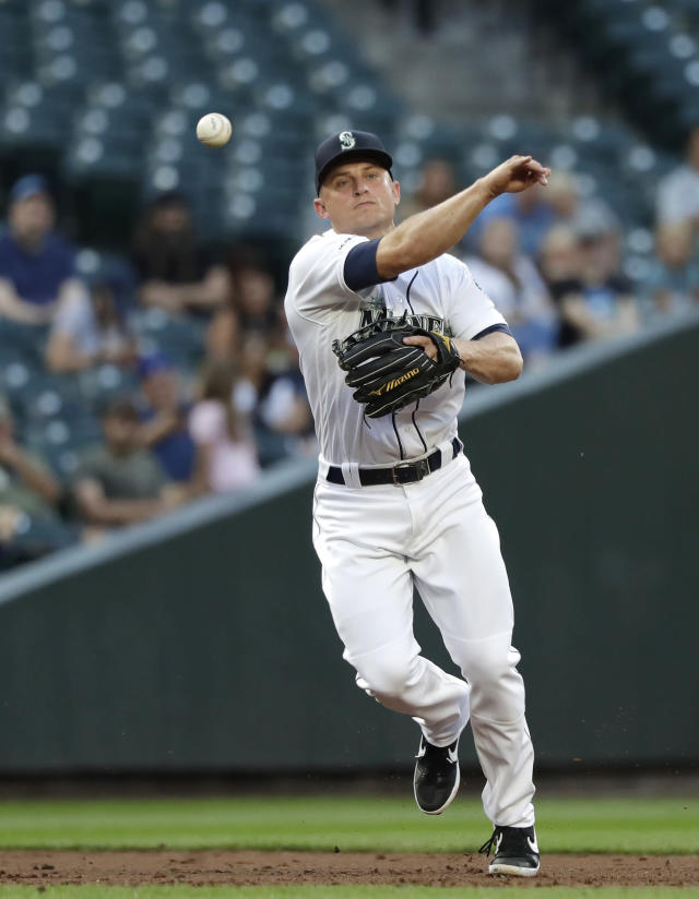 Seattle Mariners third baseman Kyle Seager throws to first base after fielding a grounder from Texas Rangers' Hunter Pence in the third inning of a baseball game, Monday, July 22, 2019, in Seattle. Pence was out on the play. (AP Photo/Elaine Thompson)