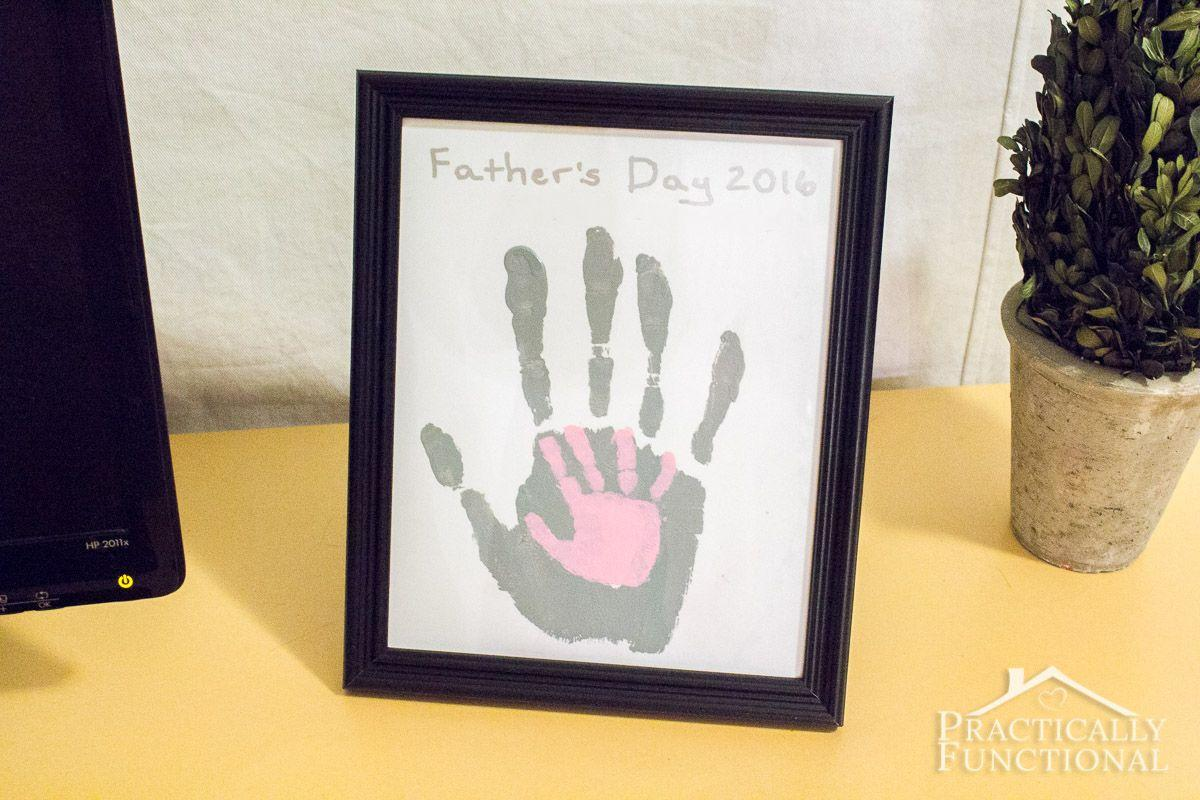 """<p>Holding hands, in art form!  </p><p><strong>Get the tutorial at <a href=""""https://www.practicallyfunctional.com/diy-fathers-day-handprint-craft/"""" target=""""_blank"""">Practically Functional.</a></strong></p>"""