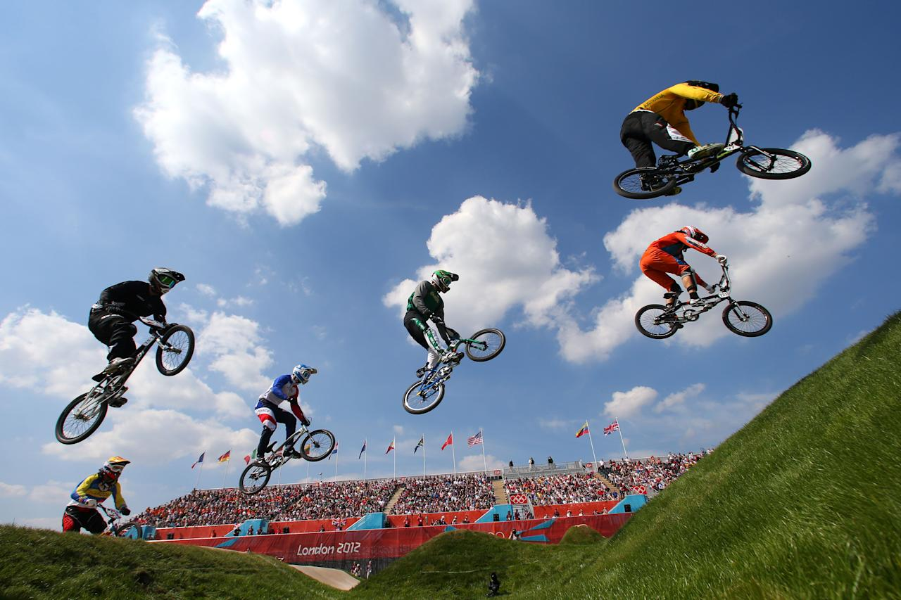 LONDON, ENGLAND - AUGUST 09:  Action as the field make their way across a jump in the Men's BMX Cycling Quarter Finals on Day 13 of the London 2012 Olympic Games at BMX Track on August 9, 2012 in London, England.  (Photo by Phil Walter/Getty Images)