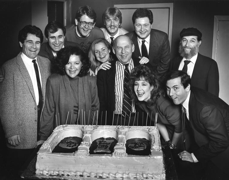"This 1986 photo provided by The Second City shows Bernard Sahlins, co-founder of The Second City, posing with actors during an opening night party in Chicago. Sahlins, who nurtured the early careers of many of the earliest stars of ""Saturday Night Live,"" died Sunday, June 16, 2013. He was 90. Sahlins and business partners Howard Alk and Paul Sills opened The Second City in December 1959, and it quickly gained national attention and helped establish Chicago as a vibrant comedy town. In the back row are: Rick Hall, Richard Kind, Harry Murphy, Craig Taylor, Jim Fay, and Fred Kaz In the front row are: Joyce Sloane, Bonnie Hunt, Sahlins, Maureen Kelly and Dan Castellaneta. (AP Photo/'Courtesy of The Second City, Jennifer Girard)"