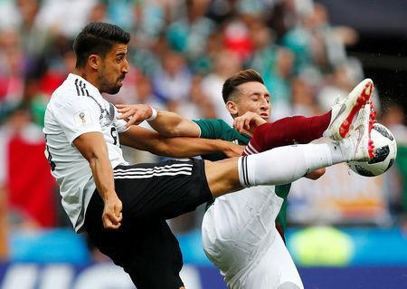 Soccer Football - World Cup - Group F - Germany vs Mexico - Luzhniki Stadium, Moscow, Russia - June 17, 2018 Germany's Sami Khedira in action with Mexico's Hector Herrera REUTERS/Axel Schmidt