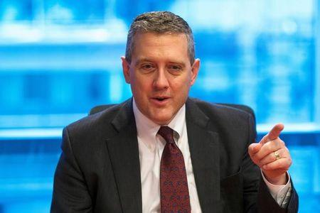 FILE PHOTO: St. Louis Fed President James Bullard speaks about the U.S. economy during an interview in New York