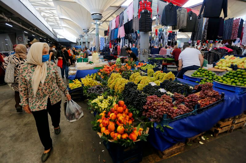FILE PHOTO: People shop at a local market in Istanbul