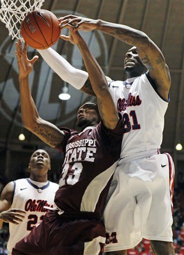 Mississippi State forward Arnett Moultrie (23) and Mississippi forward Murphy Holloway (31) fight for a rebound while Mississippi forward Reginald Buckner watches in the first half of their NCAA college basketball game in Oxford, Miss., Wednesday, Jan. 18, 2012. (AP Photo/Rogelio V. Solis)