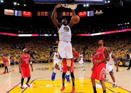Festus Ezeli (31) dunks as Houston forward Trevor Ariza (1) looks on during the Western Conference Finals. (Reuters)
