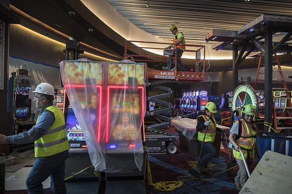 Slot machines sit wrapped in plastic as workers finish construction on the gaming floor of the $1.2 billion Resorts World Catskills casino, hotel and entertainment complex, operated by Empire Resorts Inc. in Monticello, New York, on Friday, Jan. 26, 2018. Empire Resorts, controlled by Lim Kok Thay, chairman of Genting Bhd., will open Resorts World Catskills on Feb. 8. Photographer: Victor J. Blue/Bloomberg