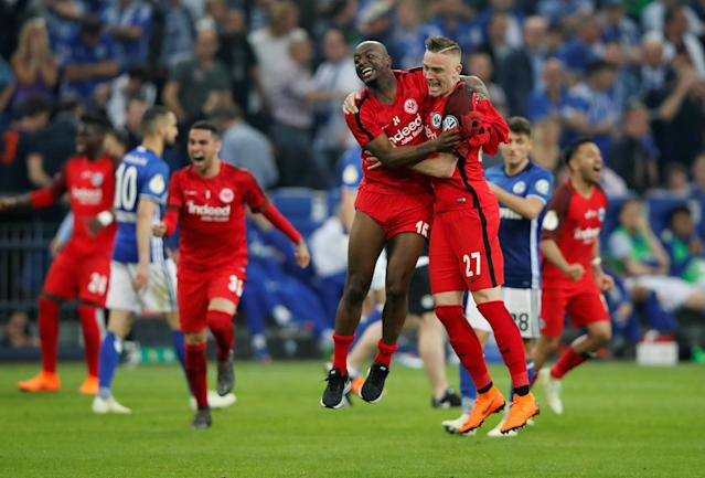 Soccer Football - DFB Cup - Schalke 04 vs Eintracht Frankfurt - Veltins-Arena, Gelsenkirchen, Germany - April 18, 2018 Eintracht Frankfurt's Jetro Willems and Marius Wolf celebrate after reaching the final REUTERS/Wolfgang Rattay DFB RULES PROHIBIT USE IN MMS SERVICES VIA HANDHELD DEVICES UNTIL TWO HOURS AFTER A MATCH AND ANY USAGE ON INTERNET OR ONLINE MEDIA SIMULATING VIDEO FOOTAGE DURING THE MATCH.