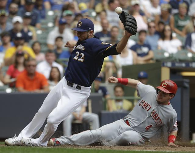 <p>Cincinnati Reds' Scooter Gennett is safe at home as Milwaukee Brewers' Matt Garza can't handle the throw during the sixth inning of a baseball game Sunday, Aug. 13, 2017, in Milwaukee. (AP Photo/Morry Gash) </p>
